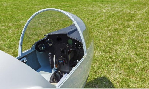 Cockpit or nose of a glider aircraft at mini airport on grass field